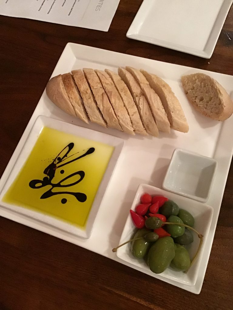 bread and oil with olives