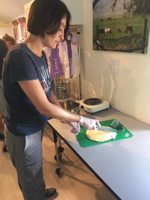 Maria milling the goat's milk mat