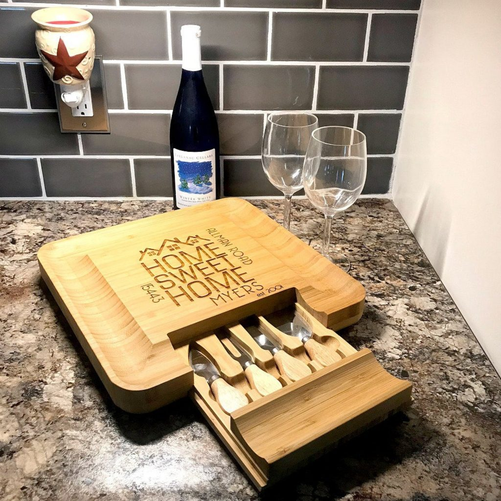 square wine and cheese board with knives