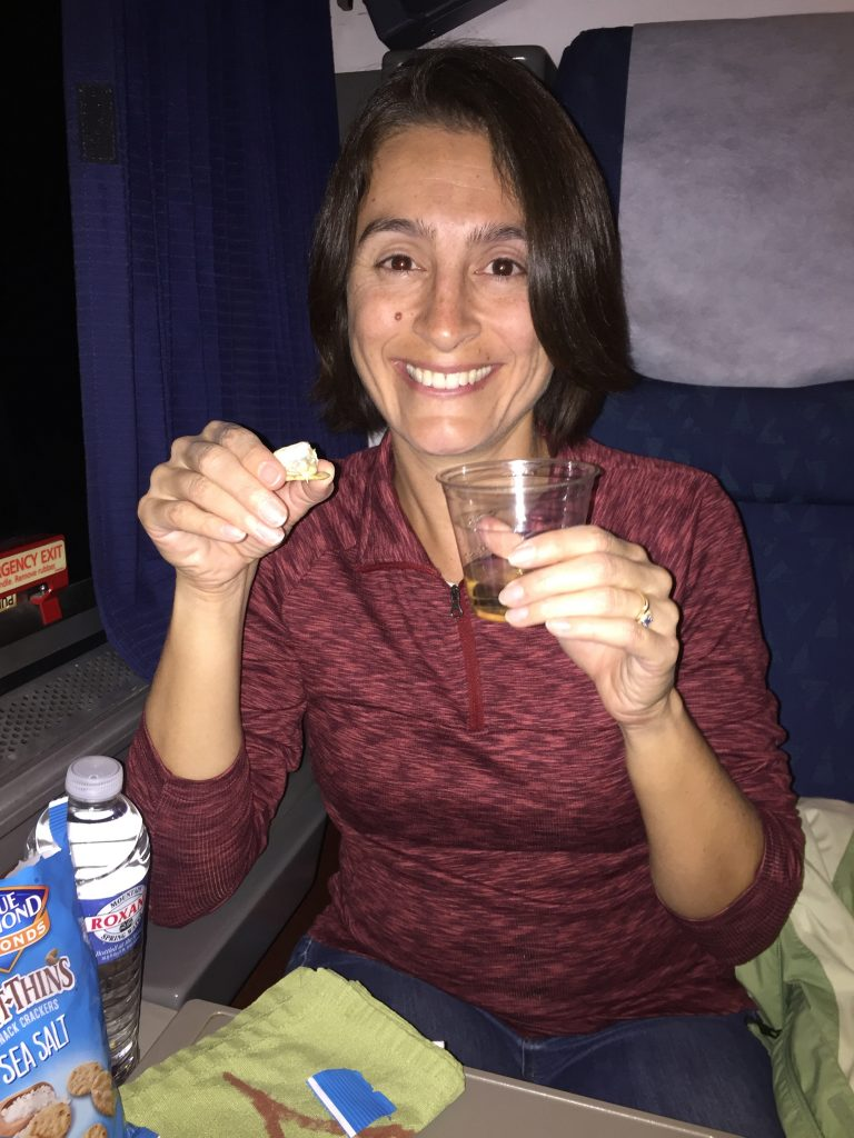 Maria with her wine and cheese on the train