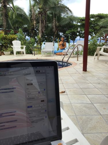 sitting poolside while I write my entry