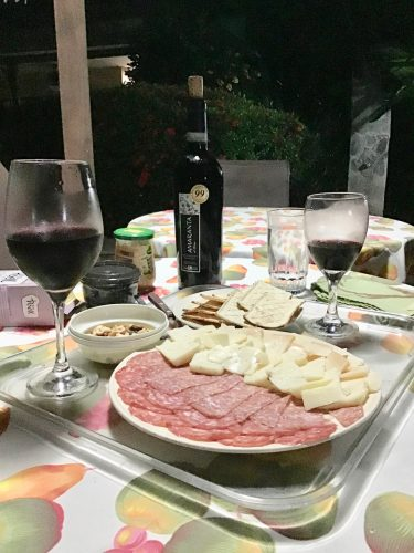 Enjoying our wine and cheese poolside